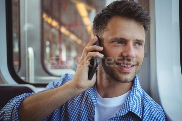 Jóképű férfi beszél mobiltelefon vonat szeretet férfi Stock fotó © wavebreak_media
