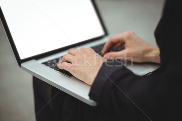 Mid section of businesswoman using laptop Stock photo © wavebreak_media