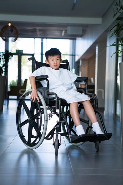 Inválido menino paciente cadeira de rodas hospital corredor Foto stock © wavebreak_media