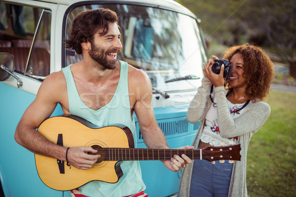 Man playing guitar while woman photographing with camera Stock photo © wavebreak_media