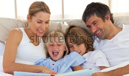 Family lying on a carpet in their living room Stock photo © wavebreak_media