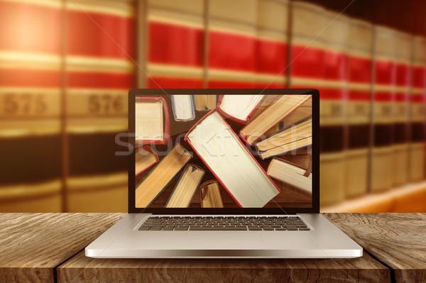 Laptop schermo grande libri legno Foto d'archivio © wavebreak_media