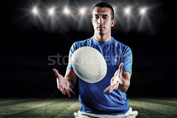 Composite image of rugby player trying to catch the ball Stock photo © wavebreak_media