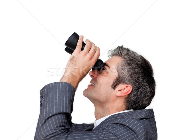 Businessman looking up through a pair of binoculars Stock photo © wavebreak_media