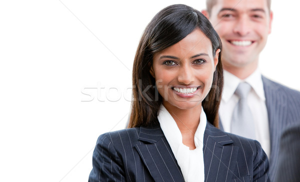 Smiling young business people standing in a row  Stock photo © wavebreak_media