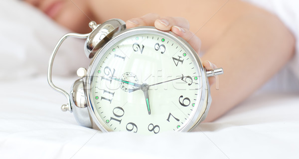 Close-up of a woman holding an alarm clock  Stock photo © wavebreak_media