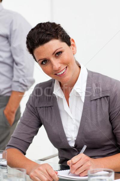Assertive young businesswoman taking notes  Stock photo © wavebreak_media