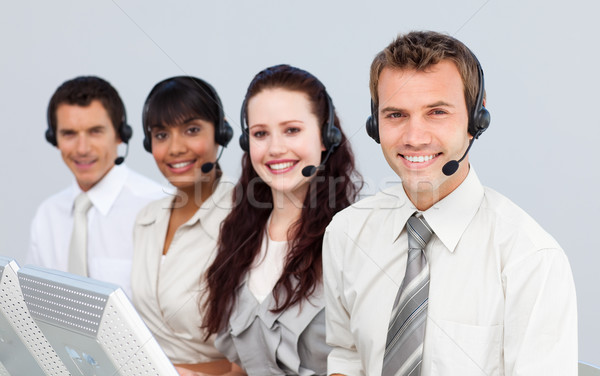 Smiling people with a headset on working in a call center Stock photo © wavebreak_media