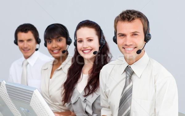 Sorridente pessoas fone trabalhando call center jovens Foto stock © wavebreak_media