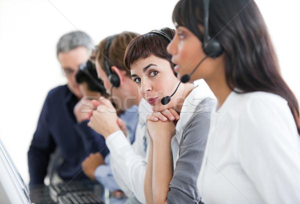 Charmant femme d'affaires casque centre d'appel équipe ordinateur Photo stock © wavebreak_media