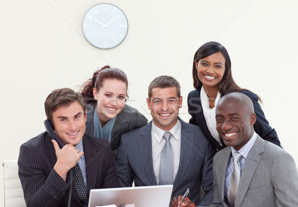 Group of people smiling in a business meeting Stock photo © wavebreak_media