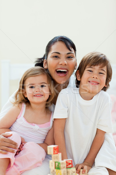Attentive mother and her children playing with cubes toys Stock photo © wavebreak_media