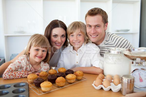 Happy family presenting their muffins Stock photo © wavebreak_media