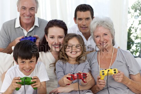 Glimlachend familie spelen video games samen sofa Stockfoto © wavebreak_media