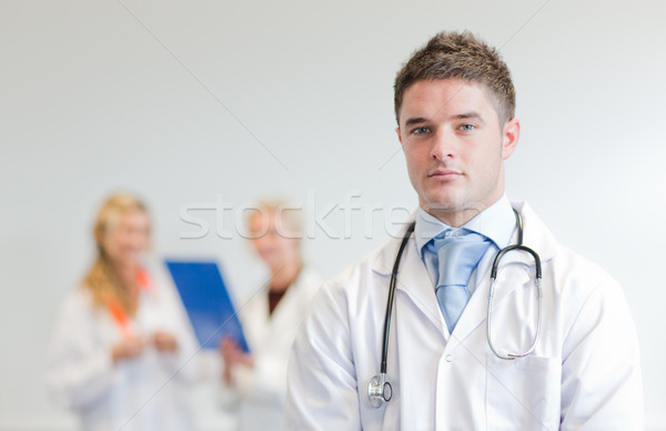 Self-assured male surgeon with his team behind him Stock photo © wavebreak_media