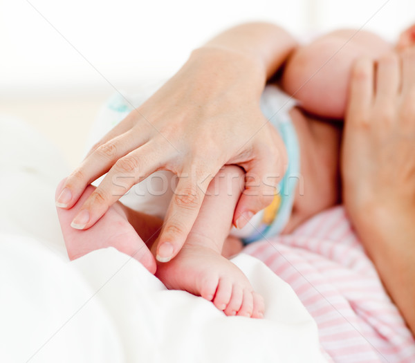 Patient's hands holding a newborn baby in bed Stock photo © wavebreak_media