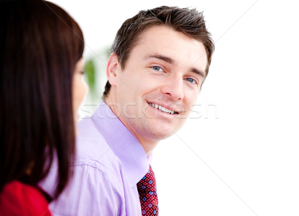 Stock photo: Smiling businessman looking at the camera