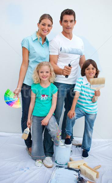 Happy family decorating their new house after move in Stock photo © wavebreak_media