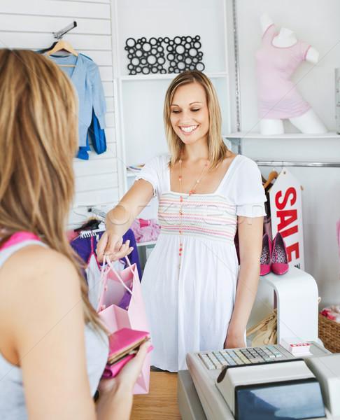 Mosolyog elarusítónő ruházat női vásárló bolt Stock fotó © wavebreak_media