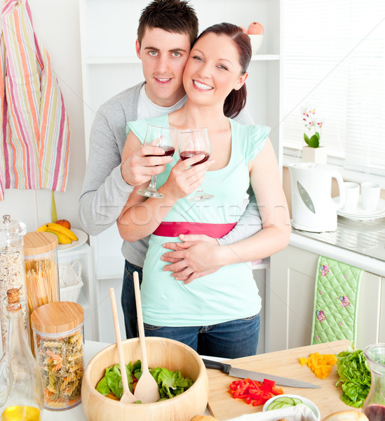 Affectionate couple drinking wine in the kitchen at home Stock photo © wavebreak_media