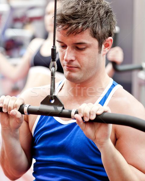 Self-assured male athlete practicing body-building Stock photo © wavebreak_media