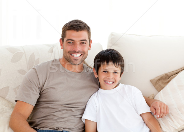 Stock photo: Portrait of adorable father and son sitting on the sofa at home