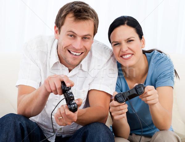радостный пару играет Видеоигры вместе диван Сток-фото © wavebreak_media