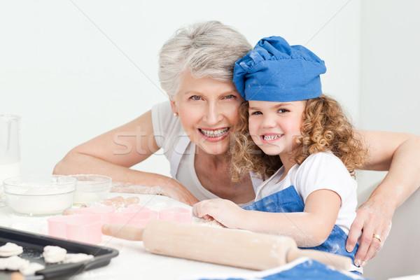 Kislány nagymama néz kamera otthon ház Stock fotó © wavebreak_media