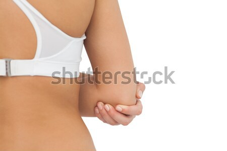 Side view of a young pregnant woman caressing her belly while standing against a white background Stock photo © wavebreak_media