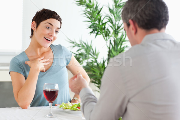 Handsome guy proposing to smiling girlfriend in a restaurant Stock photo © wavebreak_media