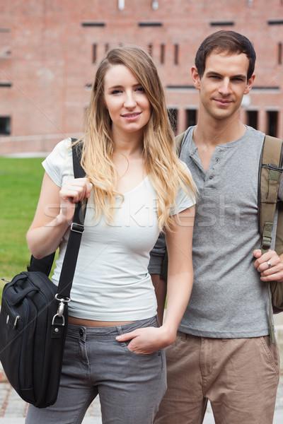 Portrait of a cute student couple posing outside a building Stock photo © wavebreak_media