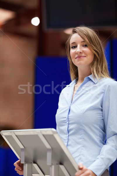 Portrait of a woman doing a presentation while looking a the camera Stock photo © wavebreak_media
