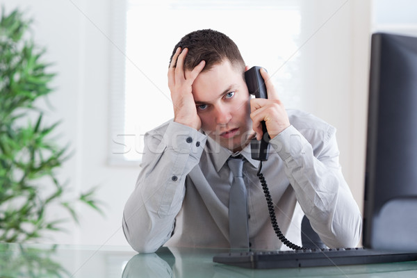 Close up of disappointed businessman getting sad news on the phone Stock photo © wavebreak_media