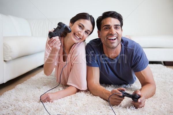çift oynama video oyunları halı ev Stok fotoğraf © wavebreak_media