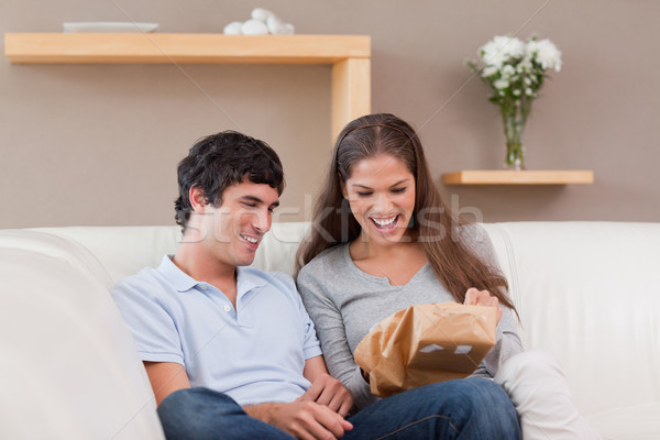 Young couple on the couch with parcel Stock photo © wavebreak_media