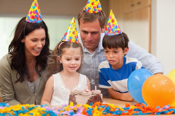 Little girl fora velas bolo de aniversário comida sorrir Foto stock © wavebreak_media