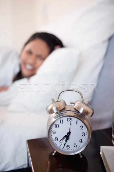 Despertador mulher jovem cama quarto travesseiro sino Foto stock © wavebreak_media