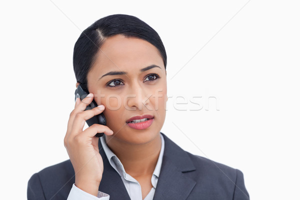 Close up of saleswoman listening to caller against a white background Stock photo © wavebreak_media