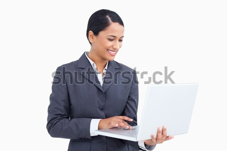 Close up of smiling saleswoman using her laptop against a white background Stock photo © wavebreak_media