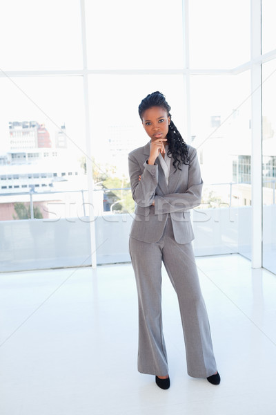 Young confident businesswoman standing in front of a window Stock photo © wavebreak_media