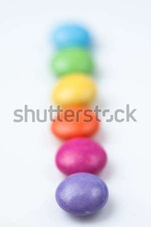 Rank of candies multi coloured against a white background Stock photo © wavebreak_media