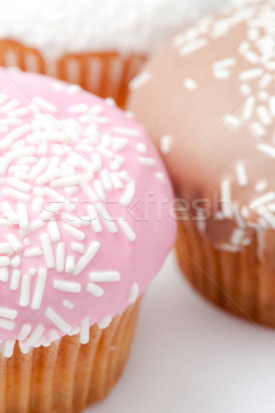 extreme close up of many muffins with icing sugar against a white background Stock photo © wavebreak_media