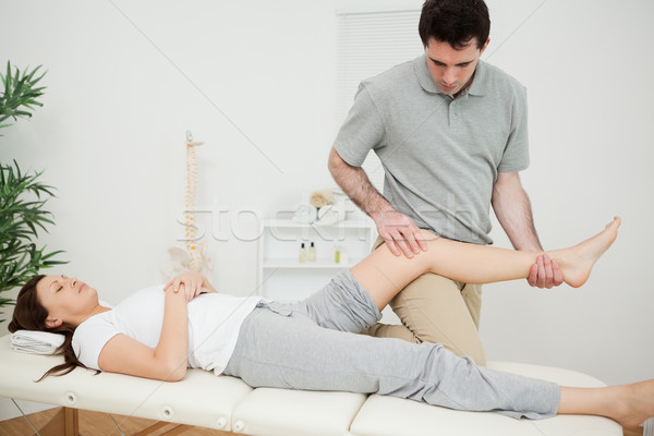 Peaceful brunette woman lying on a medical table in a physio room Stock photo © wavebreak_media