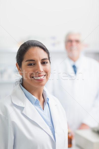 Glimlachend apotheker ziekenhuis vrouw medische vak Stockfoto © wavebreak_media