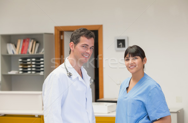 Doctor and a nurse smiling in hospital reception Stock photo © wavebreak_media