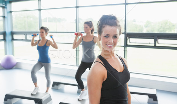 Happy woman at aerobics class in gym Stock photo © wavebreak_media