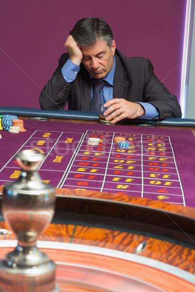 男 寝 座って 表 お金 ガラス ストックフォト © wavebreak_media