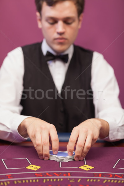 Dealer shuffling the deck of cards at poker table Stock photo © wavebreak_media