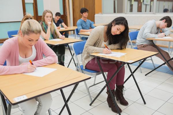 Insanlar oturma sınıf yazı kalem kalem Stok fotoğraf © wavebreak_media