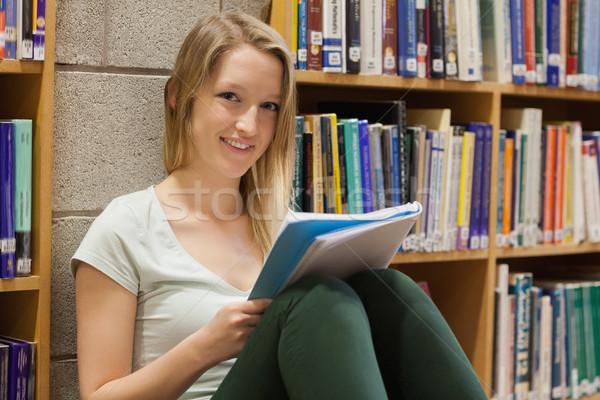 Kadın oturma kütüphane zemin gülümseyen kadın gülen Stok fotoğraf © wavebreak_media